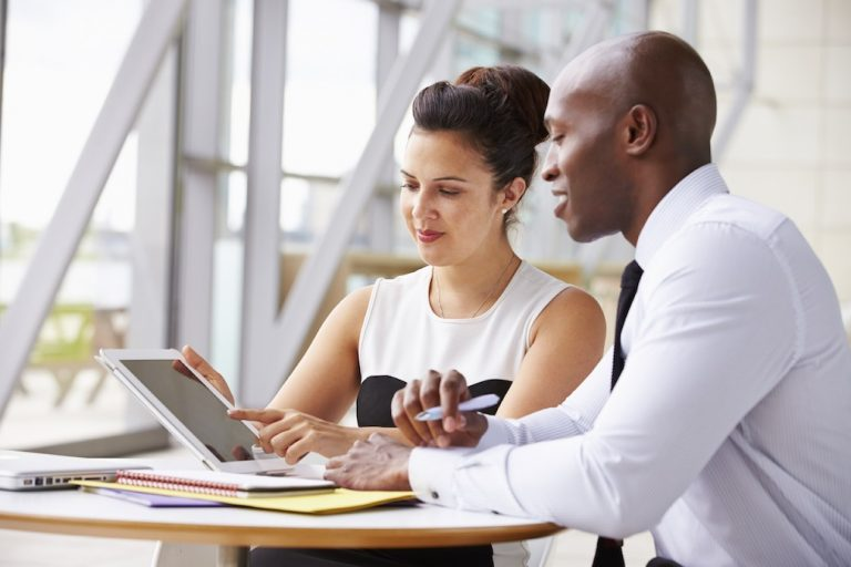 Image: Caucasian woman and African-American man in business meeting