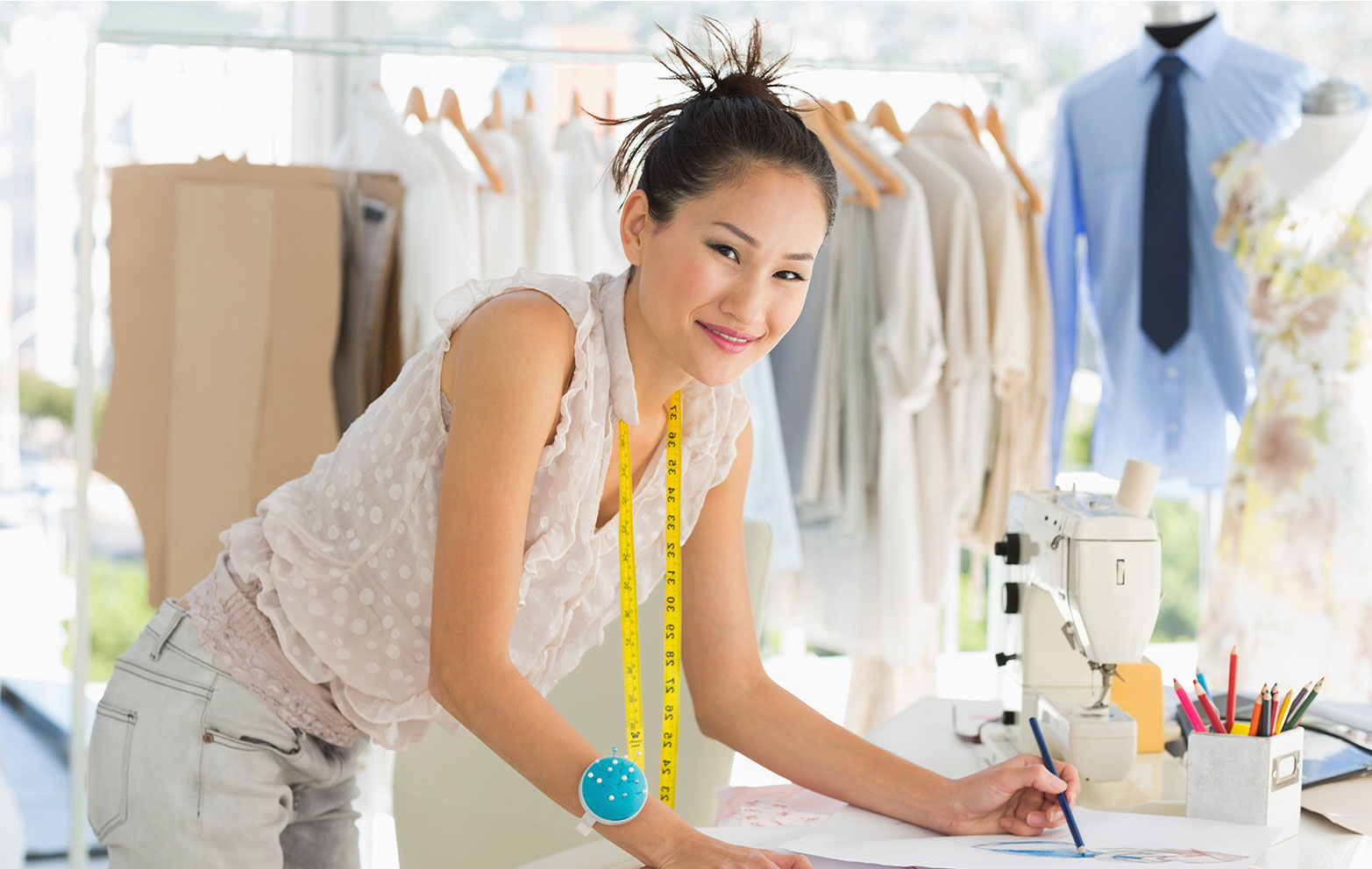 Clothing designer is working her small business