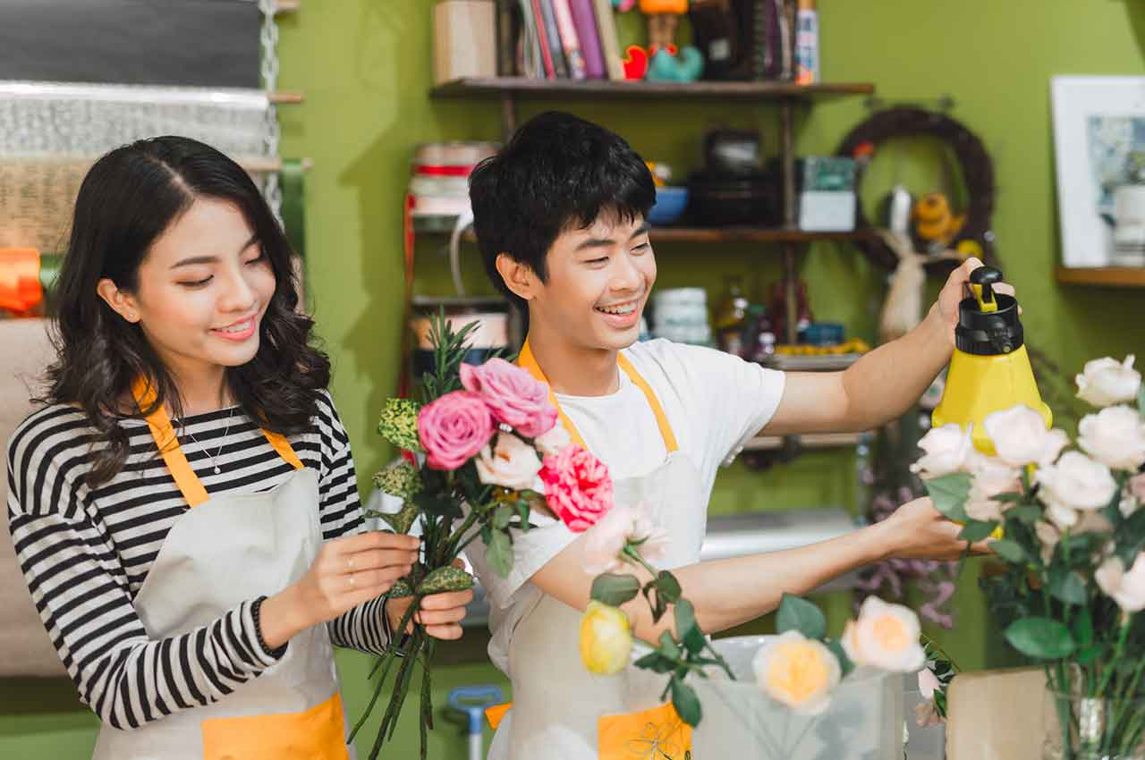 Small business owners are growing their business in a flower shop