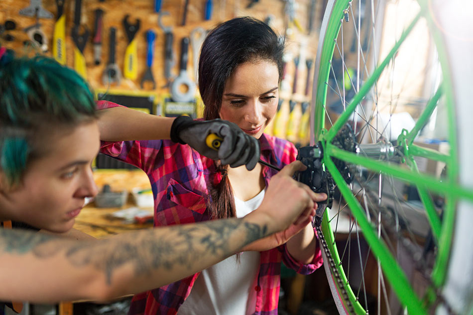 Small business woman bike owner working on bikes